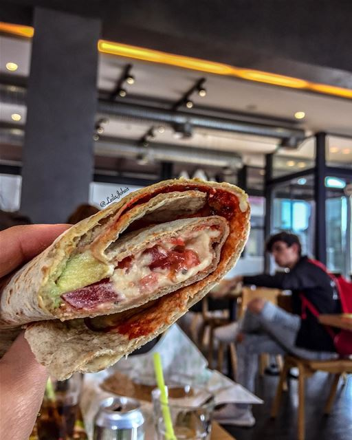 i think he is having a fight with my hummus and avocado wrap... foodie ... (Zaatar W Zeit)